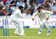<p>India's Virat Kohli (right) celebrates catching the ball from England's Joe Root during day five of the cinch Second Test match at Lord's, London. Picture date: Monday August 16, 2021. (Photo by Zac Goodwin/PA Images via Getty Images)</p>