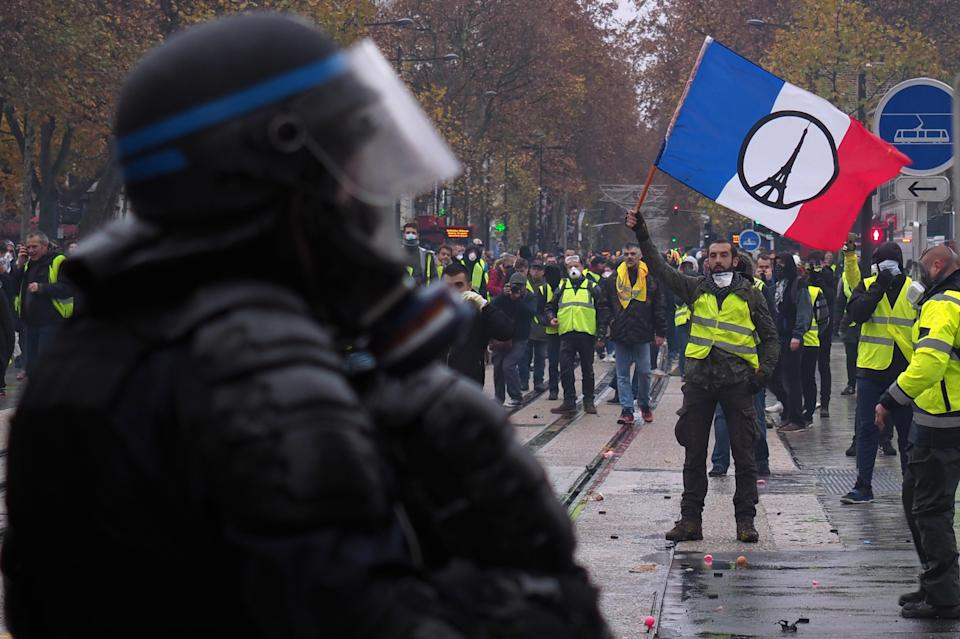 Rising populism: Yellow vests (Gilets jaunes) protesters stand in front of French riot police during a demonstration against rising oil prices and living costs in Tours, central France on December 1, 2018. Photo: GUILLAUME SOUVANT/AFP/Getty Images