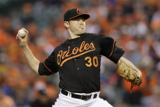 Baltimore Orioles starting pitcher Chris Tillman throws to the Toronto Blue Jays in the first inning of a baseball game, Friday, July 12, 2013, in Baltimore. (AP Photo/Patrick Semansky)
