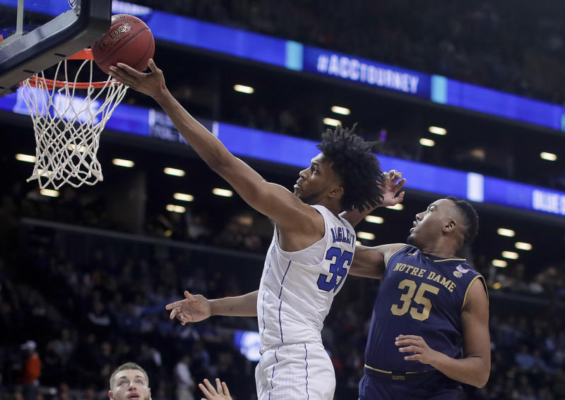 Duke forward Marvin Bagley III (35) shoots against Notre Dame forward Bonzie Colson (35) during the second half of an NCAA college basketball game in the Atlantic Coast Conference men's tournament Thursday, March 8, 2018, in New York. (AP Photo/Julie Jacobson)