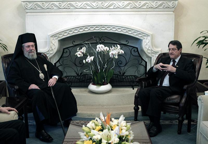 Cypriot President Nicos Anastasiades, right, meets with Cypriot Archbishop Chrysostomos II at Presidential palace in Nicosia, Wednesday, March 20, 2013. Following the talks with President Anastasiades, the head of Cyprus' influential Orthodox church Archbishop Chrysostomos II said on Wednesday that he will put the church's assets at the country's disposal to help pull it out of a financial crisis. Cypriot lawmakers have rejected a critical draft bill that would have seized part of people's bank deposits in order to qualify for a vital international bailout. (AP Photo/Petros Giannakouris)