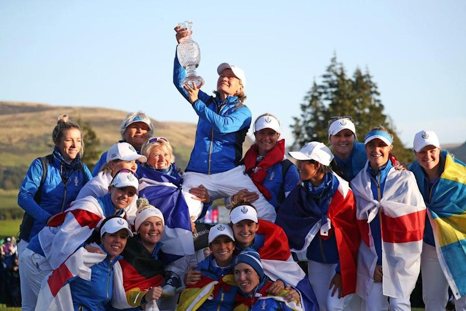 Team Europe captain Catriona Matthew (top) celebrates with her team and the trophy after winning the 2019 Solheim Cup (PA) (PA Archive)