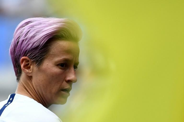"""President Donald Trump accuses US women's World Cup soccer star Megan Rapinoe of """"disrespect"""" after she swore never to visit his White House (AFP Photo/FRANCK FIFE)"""