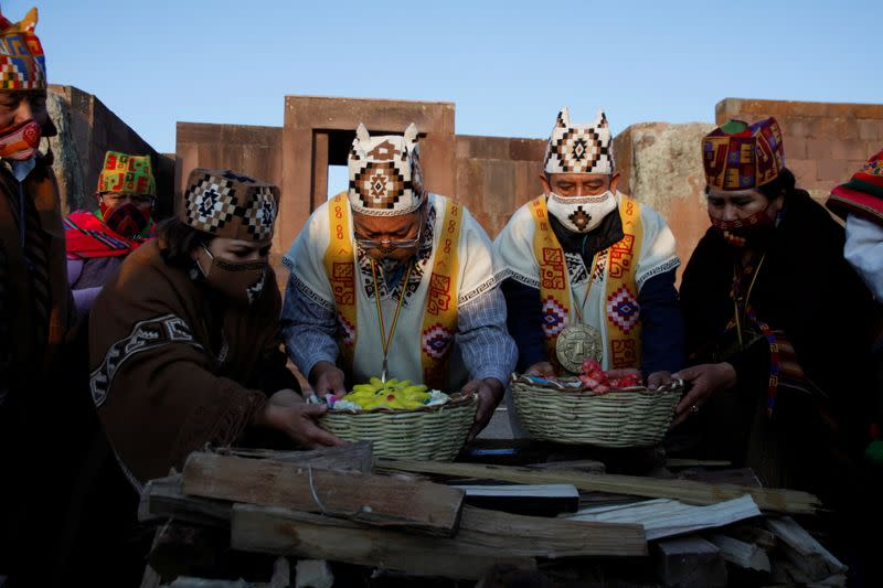 Bolivia's President-elect Luis Arce and Vice President-elect David Choquehuanca participate in an indigenous ceremony at the ancient site of Tiwanaku