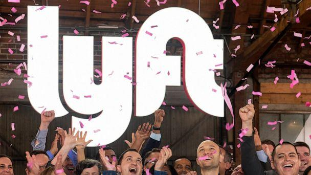 PHOTO: In this Friday, March 29, 2019 file photo, Lyft co-founders John Zimmer, front second from left, and Logan Green, front second from right, cheer as they as they ring a ceremonial opening bell in Los Angeles, to mark trading on the Nasdaq exchange. (AP Photo/Ringo H.W. Chiu)