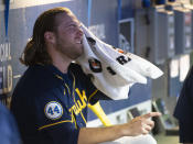 Milwaukee Brewers starting pitcher Corbin Burnes dries off between the sixth and seventh innings of a baseball game against the Cleveland Indians in Cleveland, Saturday, Sept. 11, 2021. (AP Photo/Phil Long)