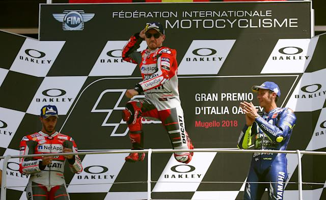 Motorcycling - MotoGP - Italian Grand Prix - Mugello Circuit, Scarperia, Italy - June 3, 2018 Ducati Team's Jorge Lorenzo (C) celebrates winning the race on the podium alongside runner up Ducati's Andrea Dovizioso (L) and third place Movistar Yamaha MotoGP's Valentino Rossi (R) REUTERS/Alessandro Bianchi TPX IMAGES OF THE DAY