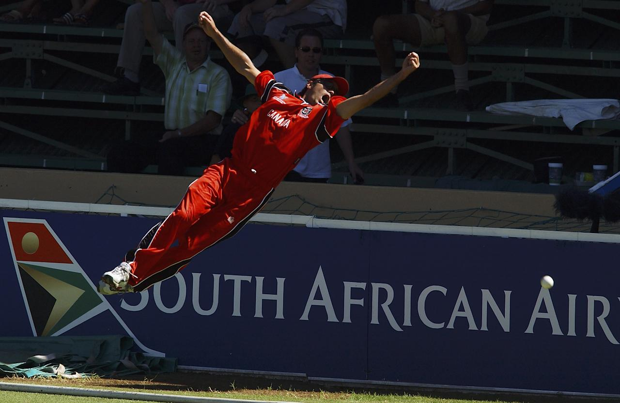 BENONI - MARCH 3:  John Davison of Canada dives for a catch during the ICC Cricket World Cup 2003 Pool B match between Canada and New Zealand held on March 3, 2003 at the Willowmoore Park, in Benoni, South Africa. New Zealand won the match by 5 wickets. (Photo by Nick Laham/Getty Images)