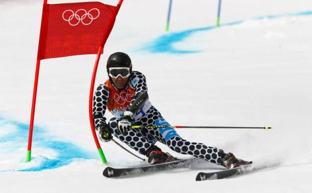 Argentina's Simari Birkner clears a gate during the first run of the men's alpine skiing giant slalom event at the 2014 Sochi Winter Olympics