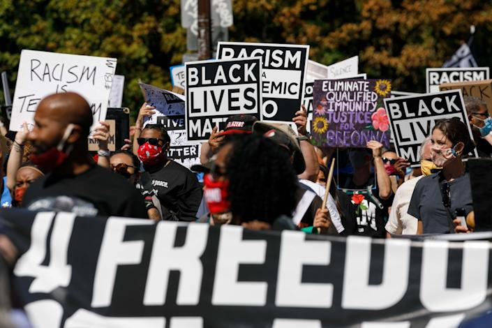 Protesters hold banners during a march led by the NAACP and a youth group, Fridays 4 Freedom, to commemorate Martin Luther King's 1963 Washington DC march, at the Convention Center in Portland, Oregon, on August 28, 2020. (John Rudoff/Anadolu Agency via Getty Images)