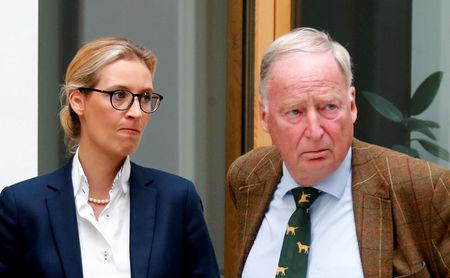 FILE PHOTO: Alice Weidel (L) and Alexander Gauland of the anti-immigration party Alternative for Germany (AFD) react before they address a news conference in Berlin, Germany August 21, 2017. REUTERS/Fabrizio Bensch/File Photo