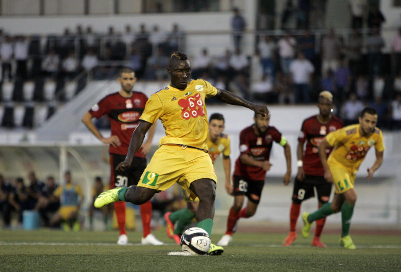 JS Kabylie's Cameroonian striker Albert Ebosse (C) converts a penalty during his team's match with USM Alger in the city of Tizi-Ouzou, on August 23, 2014