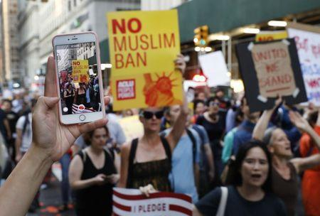 People protesting against U.S. President Donald Trump's immigration policies are captured on a cellular phone during a demonstration in New York City, U.S., June 26, 2018. REUTERS/Brendan Mcdermid