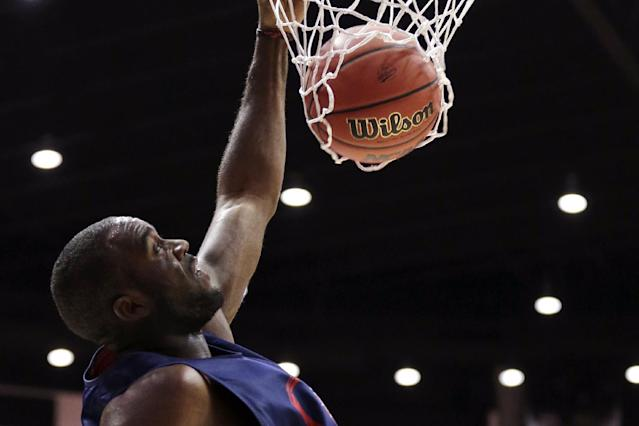 Gonzaga forward Sam Dower dunks during practice at the NCAA college basketball tournament Thursday, March 20, 2014, in San Diego. Gonzaga faces Oklahoma State in a second-round game on Friday. (AP Photo/Gregory Bull)