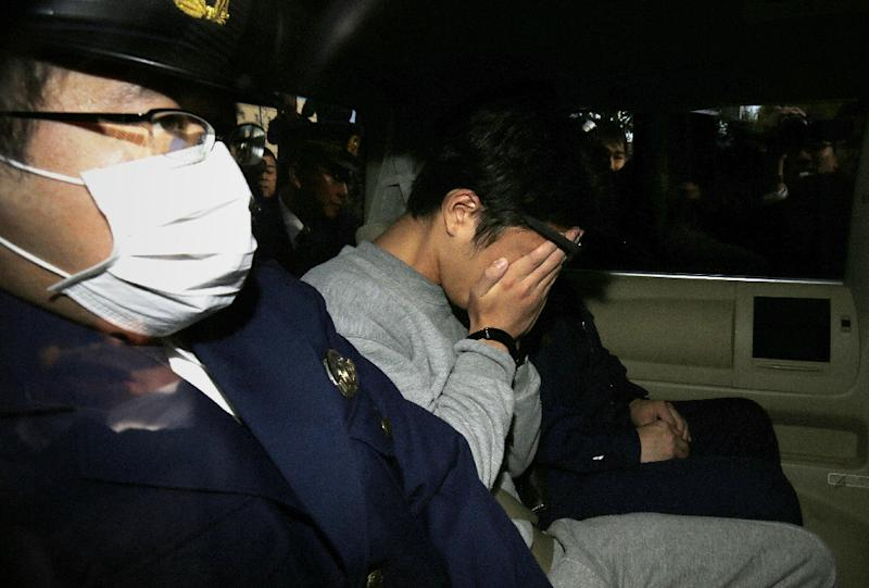 Takahiro Shiraishi has been charged with murder, the first of an expected series of charges for a man who has admitted killing and dimembering nine peopl in his Tokyo apartment (AFP Photo/STR)