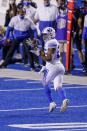 BYU running back Tyler Allgeier (25) turns to catch the ball during the first half against Boise State in an NCAA college football game Friday, Nov. 6, 2020, in Boise, Idaho. (AP Photo/Steve Conner)