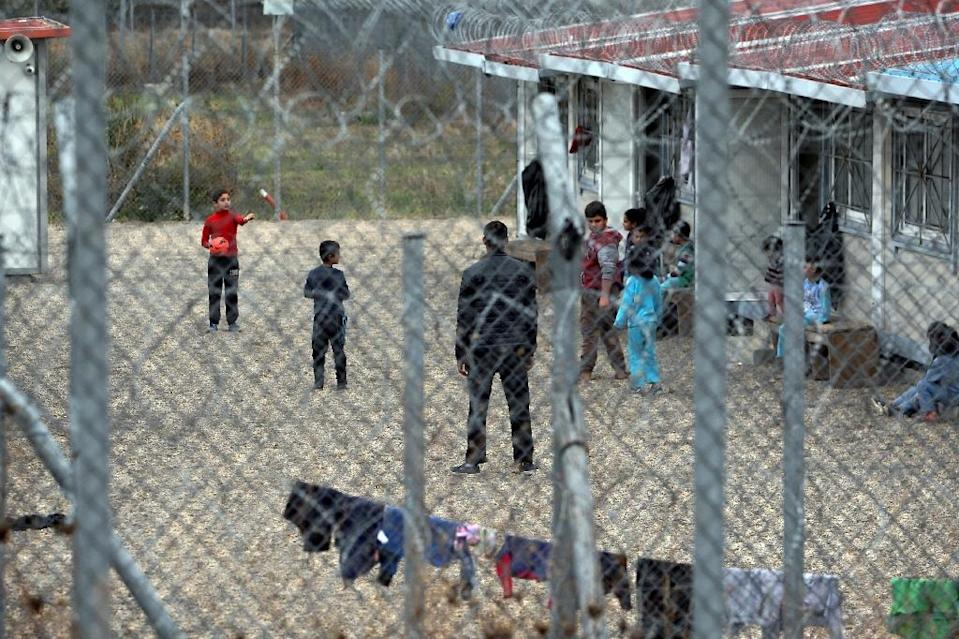 Children play outside the Filakio detention centre for migrants and refugees near the Greek-Turkish border (AFP Photo/Sakis Mitrolidis)