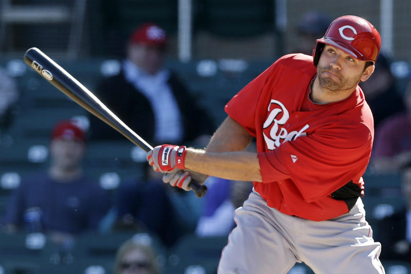 Cincinnati Reds' Joey Votto drives in a run with a single against the Arizona Diamondbacks during the sixth inning of an exhibition spring training baseball game, Wednesday, Feb. 27, 2013, in Scottsdale, Ariz. (AP Photo/Marcio Jose Sanchez)