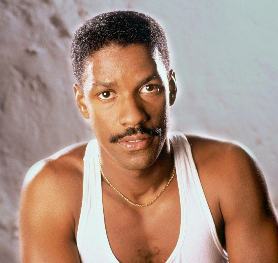 <p>Not only is young Denzel Washington serving up an impressively thick mustache, but he's proudly showing off his hairy chest, too.</p>