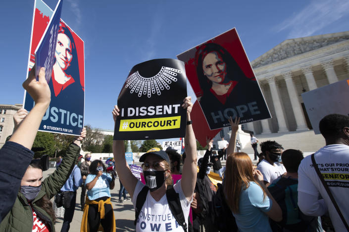 People protest for and against the confirmation of President Donald Trump's Supreme Court nominee Amy Coney Barrett, rally at the Supreme Court on Capitol Hill, in Washington, Wednesday, Oct. 14, 2020. (AP Photo/Jose Luis Magana)