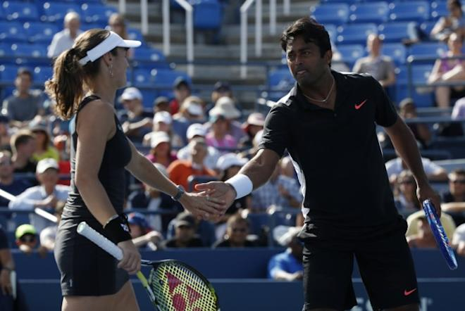 Paes, Bopanna beaten, Sania win in US Open
