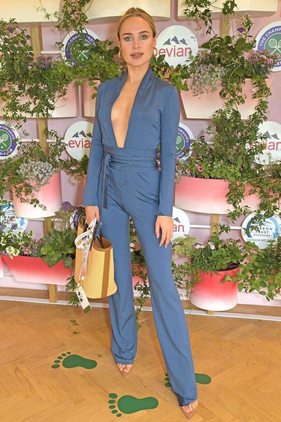 <p>Swimwear designer Kimberley Garner wore a teal-coloured jumpsuit to watch the games at Wimbledon. </p>