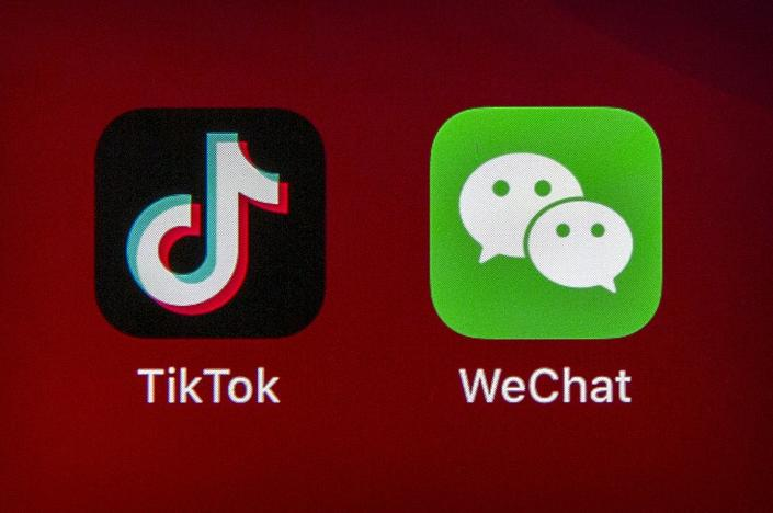 """<span class=""""caption"""">Banning TikTok and WeChat would cut off many Americans from popular social media.</span> <span class=""""attribution""""><a class=""""link rapid-noclick-resp"""" href=""""https://newsroom.ap.org/detail/ChinaUSTrumpTiktokWechatOrder/7f2007a5786340f89657a9aac86d826a/photo?Query=TikTok%20AND%20WeChat&mediaType=photo&sortBy=&dateRange=Anytime&totalCount=19&currentItemNo=3"""" rel=""""nofollow noopener"""" target=""""_blank"""" data-ylk=""""slk:AP Photo/Mark Schiefelbein"""">AP Photo/Mark Schiefelbein</a></span>"""