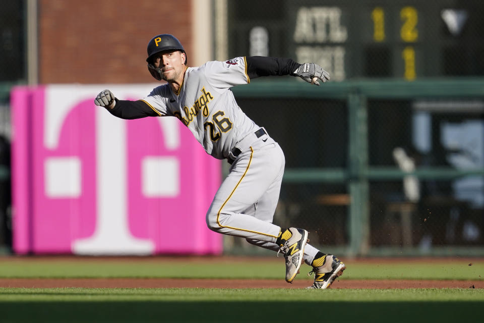 Pittsburgh Pirates' Adam Frazier runs to second base after a wild pitch by San Francisco Giants' Kevin Gausman during the first inning of a baseball game in San Francisco, Saturday, July 24, 2021. (AP Photo/Jeff Chiu)