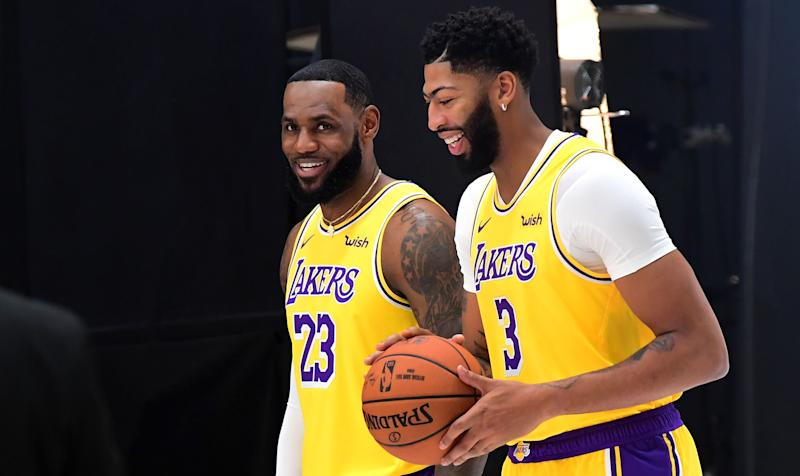 LeBron James (L) and Anthony Davis of the Los Angeles Lakers arrive for a photo shoot during Lakers Media day in El Segundo, California on September 27, 2019. (Photo by Frederic J. BROWN / AFP) (Photo credit should read FREDERIC J. BROWN/AFP/Getty Images)