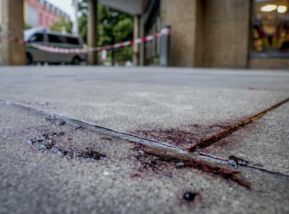 Blood is seen at the crime scene in central Wuerzburg, Germany, Saturday, June 26, 2021. German police say several people have been killed and others injured in a knife attack in the southern city of Wuerzburg on Friday.(AP Photo/Michael Probst)