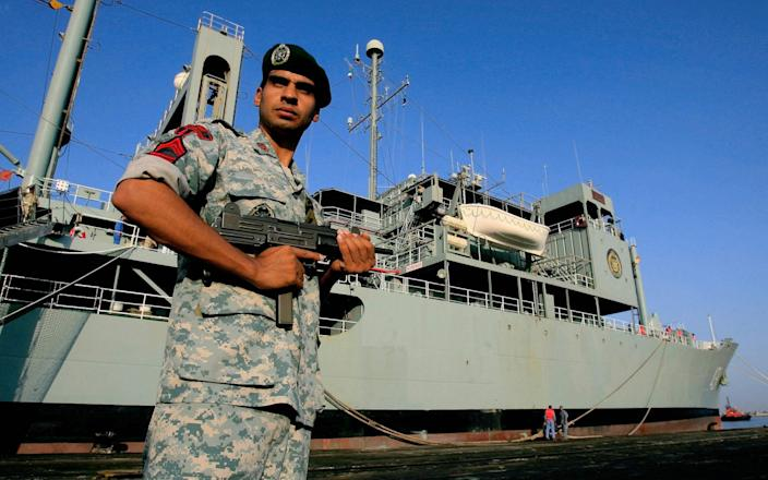 File image of an Iranian special forces soldier on guard outside a naval vessel - AFP/AFP