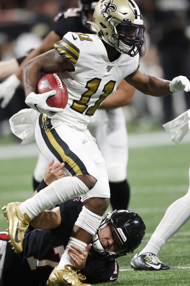 Atlanta Falcons kicker Younghoe Koo (7) tackles New Orleans Saints wide receiver Deonte Harris (11) during a kickoff during the first half of an NFL football game, Thursday, Nov. 28, 2019, in Atlanta. (AP Photo/John Bazemore)