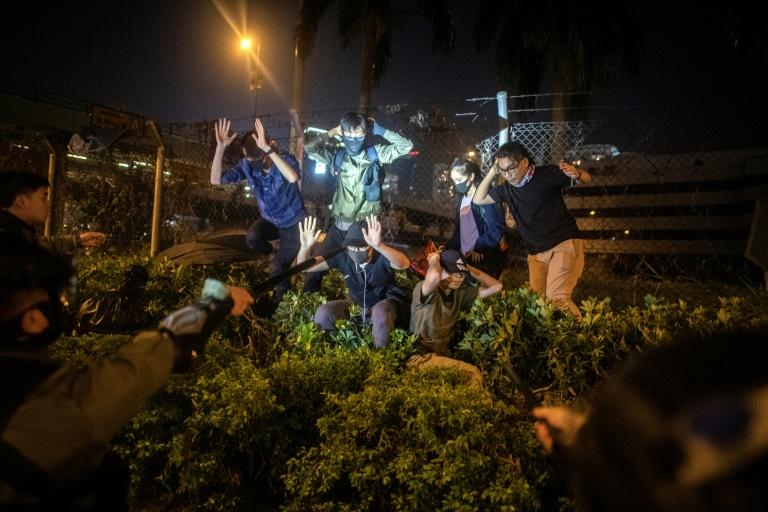 Police detain protesters and students after they tried to flee outside the Hong Kong Polytechnic University campus (AFP Photo/NICOLAS ASFOURI)