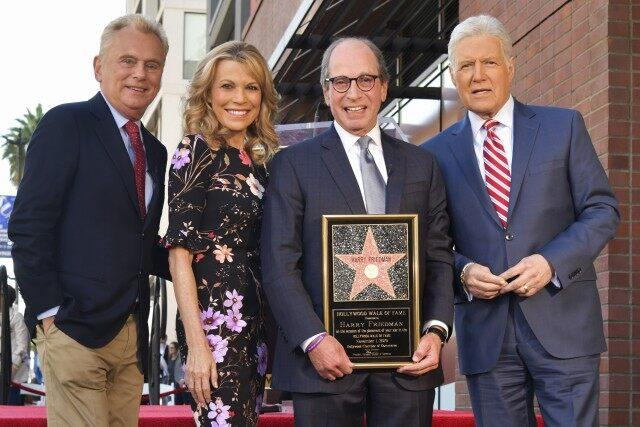 Pat Sajak, Vanna White, Harry Friedman, and Alex Trebek pose for portrait at Harry Friedman Honored With A Star On The Hollywood Walk Of Fame on November 01, 2019 in Hollywood, California.