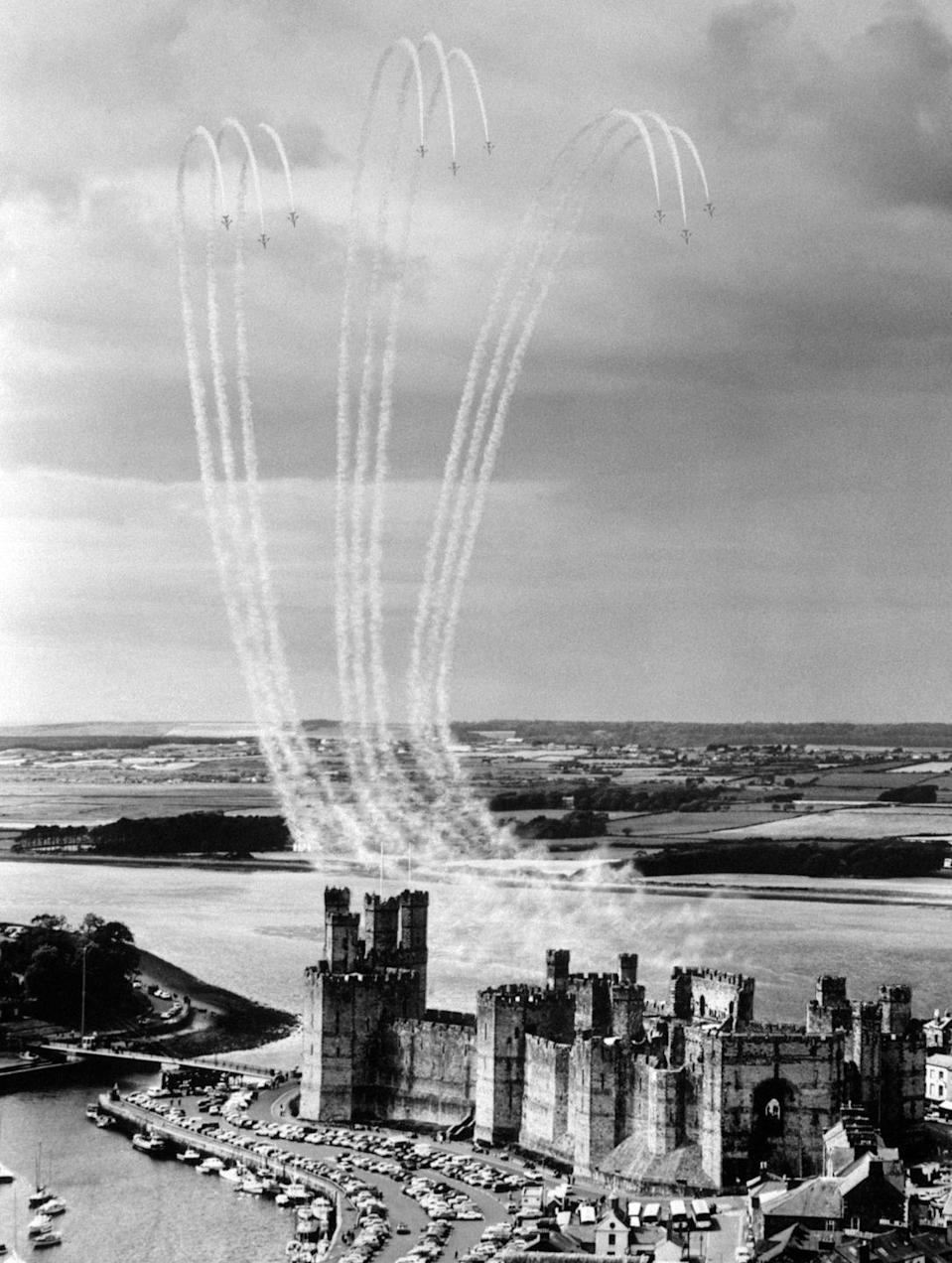 <p>On their wedding day, celebrations were seen throughout the United Kingdom. In Wales, the Royal Air Force performed a formation of the Prince of Wales Feathers over Caernarfon Castle. </p>