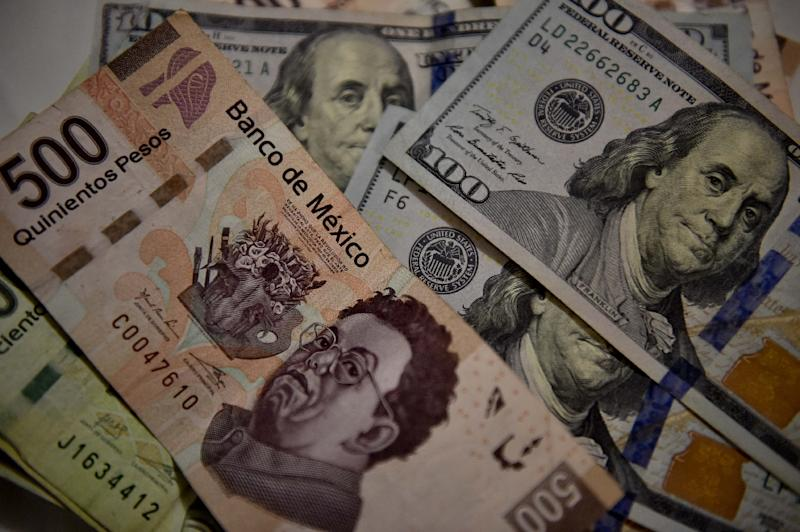 The Mexican peso is at more than one-year highs against the dollar as Donald Trump's struggles in Washington dim expectations for further interest rate hikes this year (AFP Photo/YURI CORTEZ)