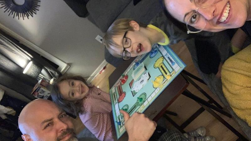Craig Stanzak and his children Kaitie, four, and Calvin, seven, and his wife, Kristin, play games at home