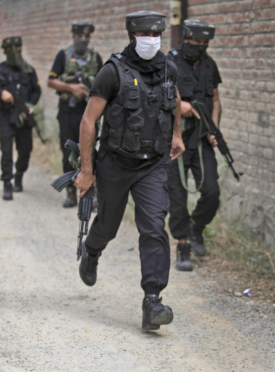 Members of Special Operations Group (SOG) of Jammu and Kashmir police arrive at the site of an attack on policemen on the outskirts of Srinagar, Indian controlled Kashmir, Friday, Aug. 14, 2020. Anti-India rebels in Indian-controlled Kashmir Friday attacked a police party in the disputed region's main city, killing two police officials and injuring another, police said. (AP Photo/Mukhtar Khan)