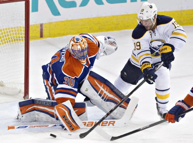 Buffalo Sabres' Cody Hodgson (19) is stopped by Edmonton Oilers goalie Ben Scrivens (30) during the third period of an NHL hockey game Thursday, March 20, 2014, in Edmonton, Alberta. Buffalo won 3-1. (AP Photo/The Canadian Press, Jason Franson)