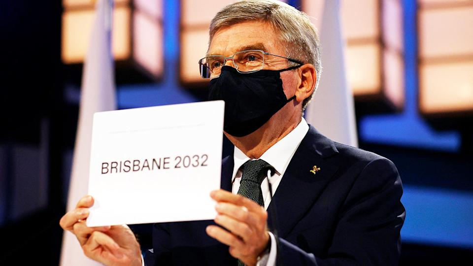 Thomas Bach, pictured here announcing Brisbane as the 2032 Summer Olympics host city.