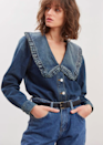 """Half western, half prairie vibes, 100% versatile. $325, The Frankie Shop. <a href=""""https://thefrankieshop.com/products/denim-shirt-with-ruffle-collar-by-ganni-in-tint-wash"""" rel=""""nofollow noopener"""" target=""""_blank"""" data-ylk=""""slk:Get it now!"""" class=""""link rapid-noclick-resp"""">Get it now!</a>"""