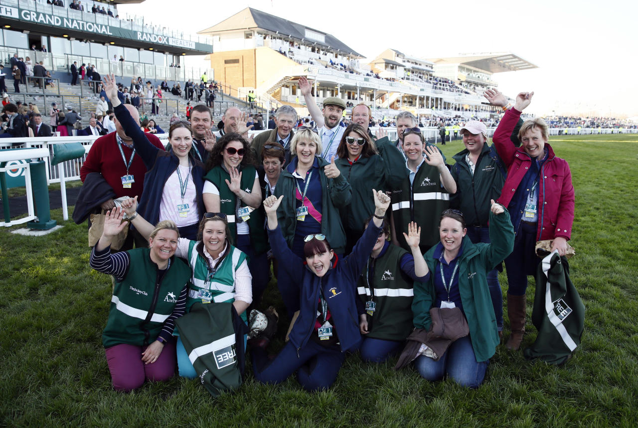 Britain Horse Racing - Grand National Festival - Aintree Racecourse - 8/4/17 Staff celebrate as they pose for a photo Action Images via Reuters / Jason Cairnduff Livepic