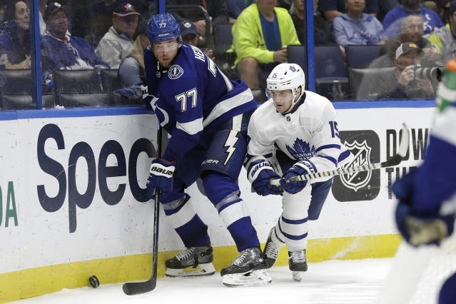 Tampa Bay Lightning defenseman Victor Hedman (77) keeps the puck from Toronto Maple Leafs center Alexander Kerfoot (15) during the third period of an NHL hockey game Tuesday, Feb. 25, 2020, in Tampa, Fla. (AP Photo/Chris O'Meara)