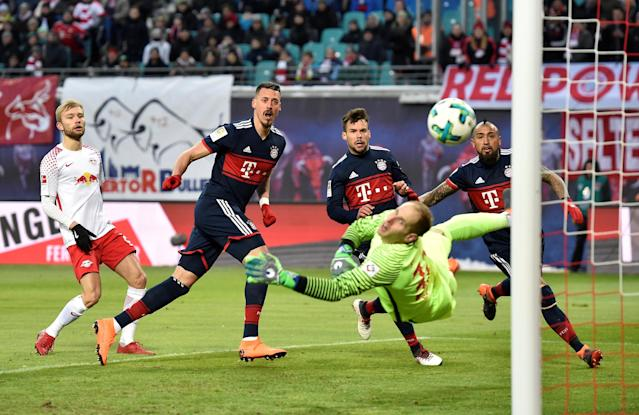 Soccer Football - Bundesliga - RB Leipzig vs Bayern Munich - Red Bull Arena, Leipzig, Germany - March 18, 2018 Bayern Munich's Sandro Wagner scores their first goal REUTERS/Matthias Rietschel DFL RULES TO LIMIT THE ONLINE USAGE DURING MATCH TIME TO 15 PICTURES PER GAME. IMAGE SEQUENCES TO SIMULATE VIDEO IS NOT ALLOWED AT ANY TIME. FOR FURTHER QUERIES PLEASE CONTACT DFL DIRECTLY AT + 49 69 650050 TPX IMAGES OF THE DAY