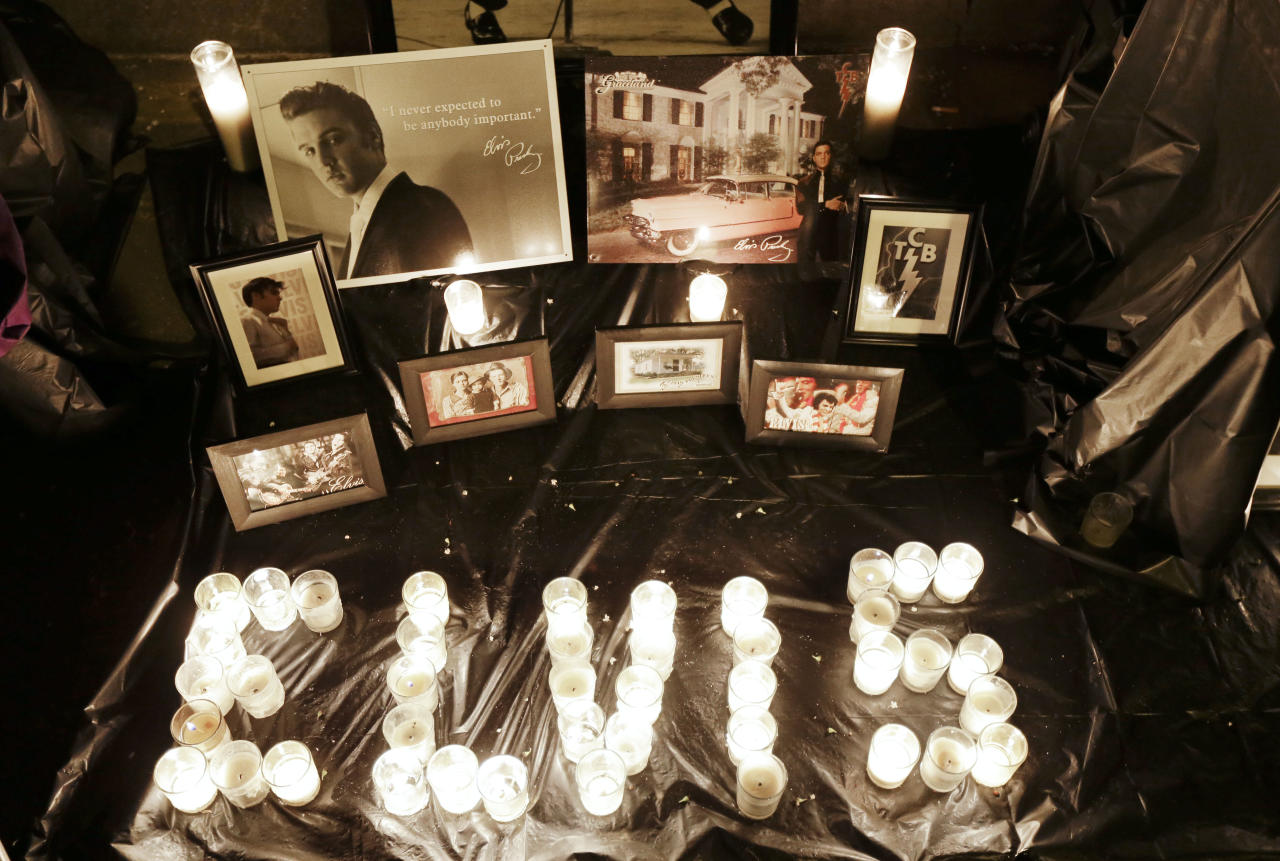 A memorial to Elvis Presley is displayed outside Graceland, Presley's Memphis, Tenn. home, on Wednesday, Aug. 15, 2012. Fans from around the world are at Graceland to commemorate the 35th anniversary of Presley's death. (AP Photo/Mark Humphrey)