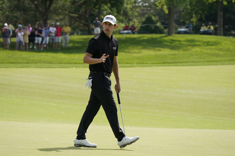 Patrick Cantlay reacts after making a birdie on the 13th hole during the final round of the Memorial golf tournament, Sunday, June 6, 2021, in Dublin, Ohio. (AP Photo/Darron Cummings)