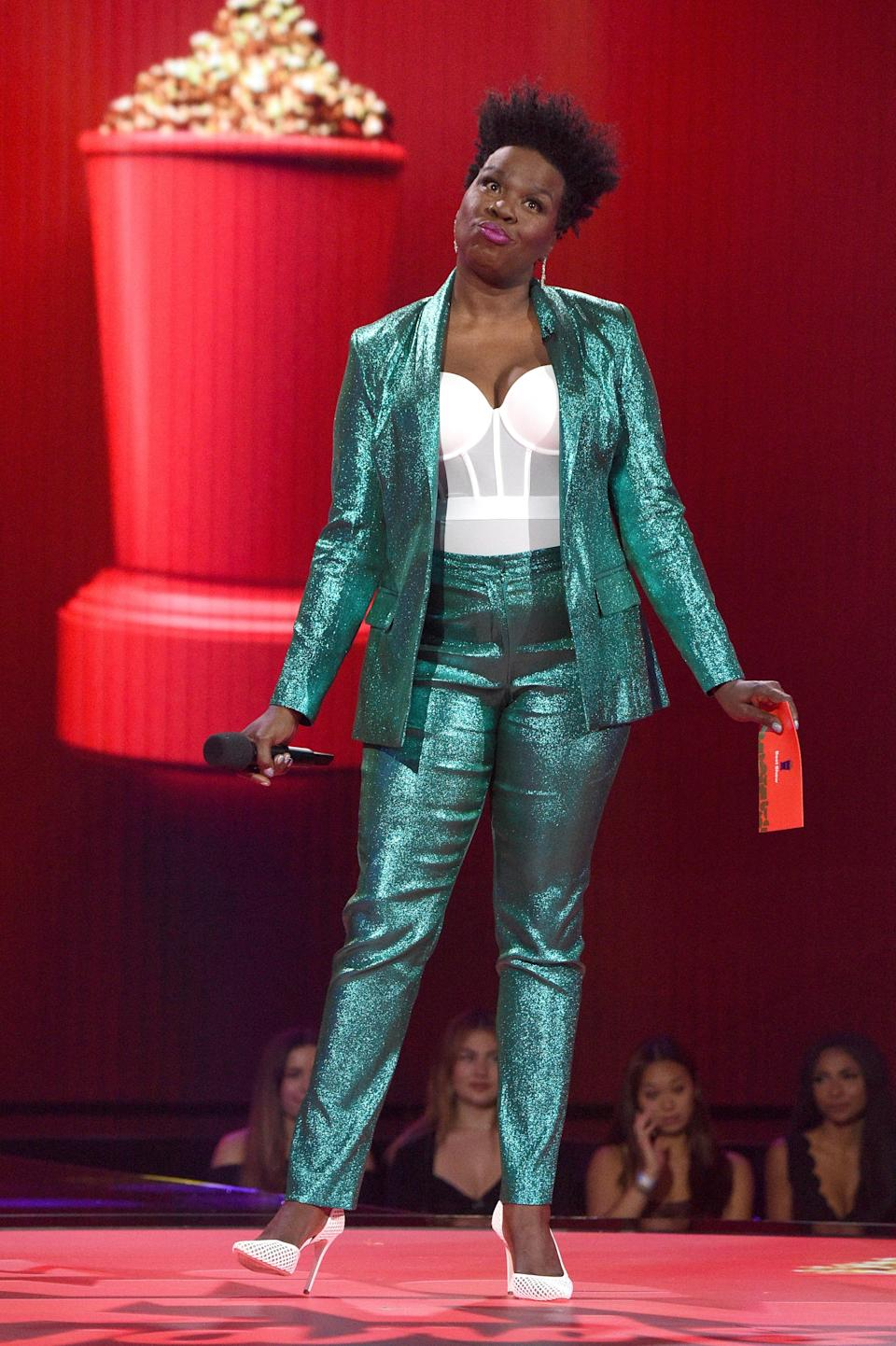 She also rocked a metallic aquamarine pant suit on stage paired with a mesh white bustier.