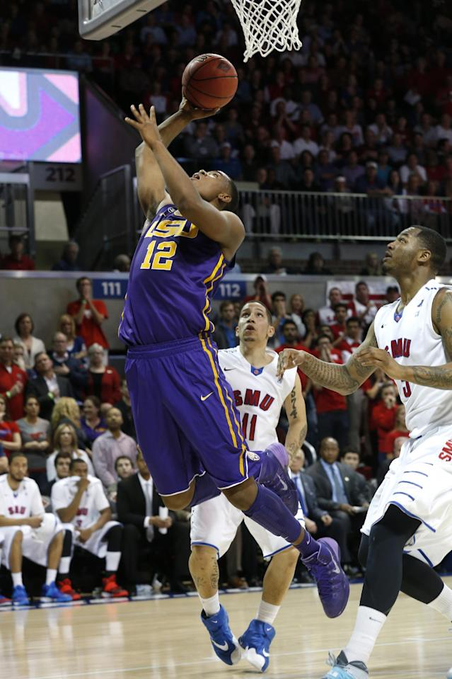 LSU forward Jarell Martin (12) puts up a shot in front of SMU guard Nic Moore (11) and forward Markus Kennedy (5) during the first half of an NCAA college basketball game in the second round of the NIT Monday, March 24, 2014, in Dallas, Texas. (AP Photo/Sharon Ellman)