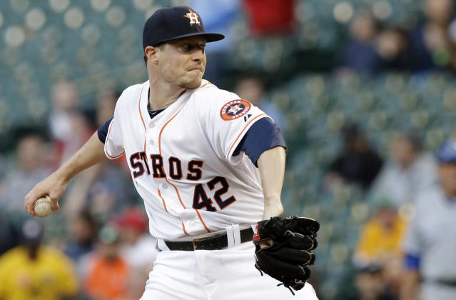 Houston Astros' Lucas Harrell winds up in the first inning of a baseball game against the Kansas City Royals on Tuesday, April 15, 2014, in Houston. All the players on both teams are wearing jerseys with No. 42 to honor Jackie Robinson. (AP Photo/Pat Sullivan)