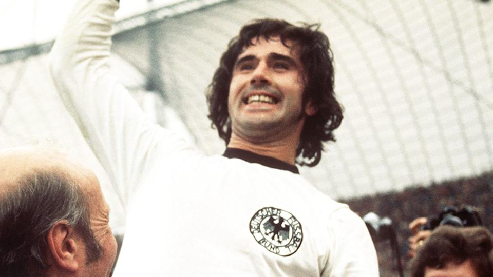 West Germany star Gerd Muller is seen here being hoisted up at the 1974 FIFA World Cup.